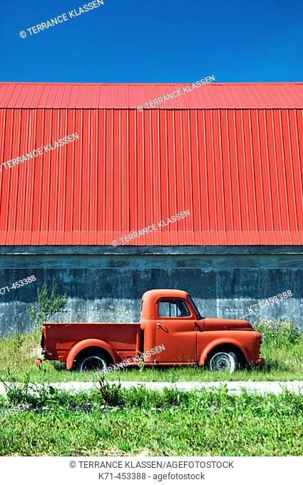 The color of red in an old truck and barn roof near Isle de Chênes, Manitoba. Canada
