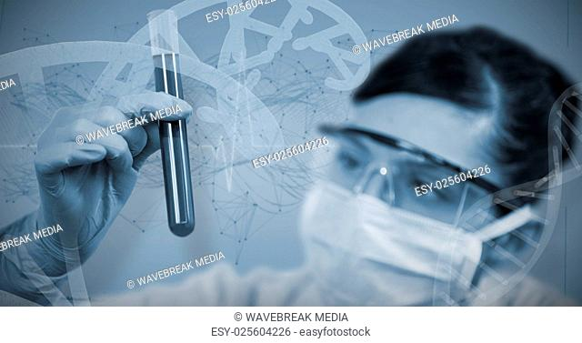 Composite image of female scientist looking at test tube
