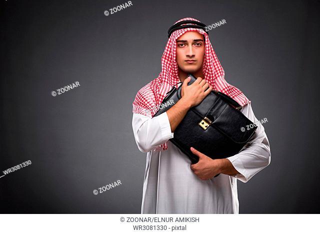 Arab businessman on gray background