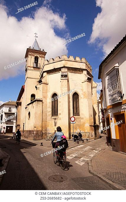 Cyclists in front of the Iglesia De San Esteban church, Seville, Andalusia, Spain, Europe
