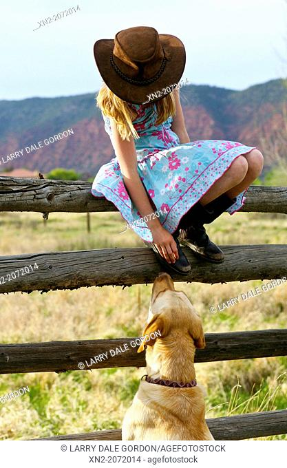 A young girl and her dog in the countryside in California, USA