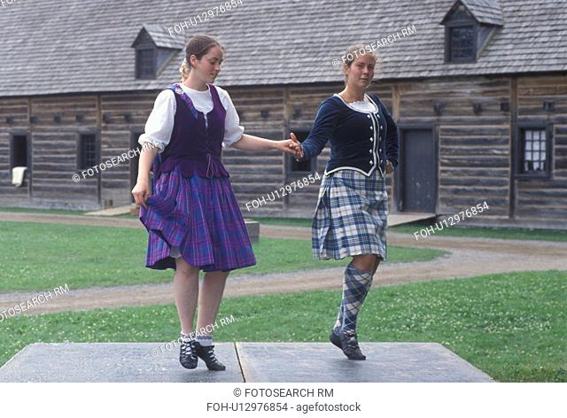 dancing, Thunder Bay, Canada, Ontario, Two girls dressed in authentic costumes celebrate Scottish Days by doing the Highland Dance at the Main Square at Old...