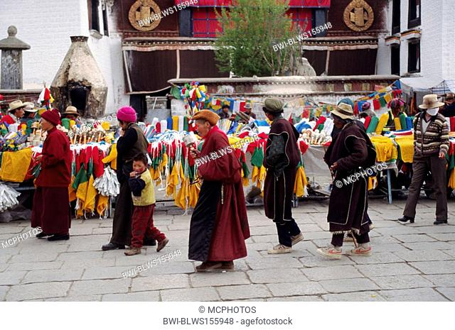 Tibetans circumnambulate the Jokhang Temple along the Barkor a Tibetan Bazaar, China, Tibet, Lhasa