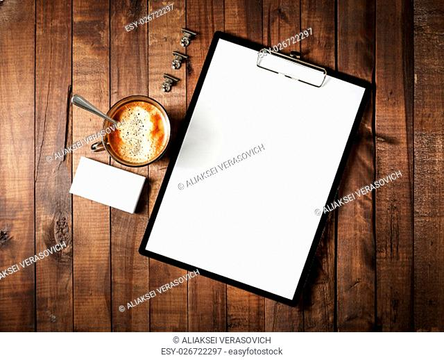 Photo of blank stationery on vintage wooden table background. Blank corporate identity template. Blank branding mock-up. Mockup for design portfolios