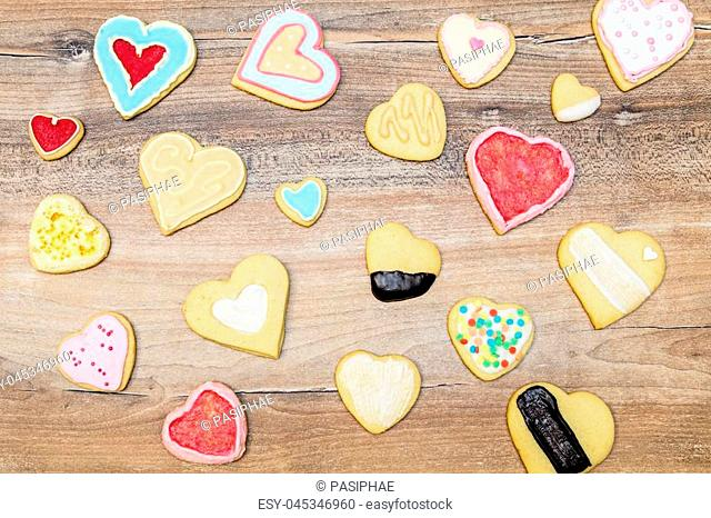 Colorful Heart cookies decorated with royal icing and frosting, concept Love and christmas