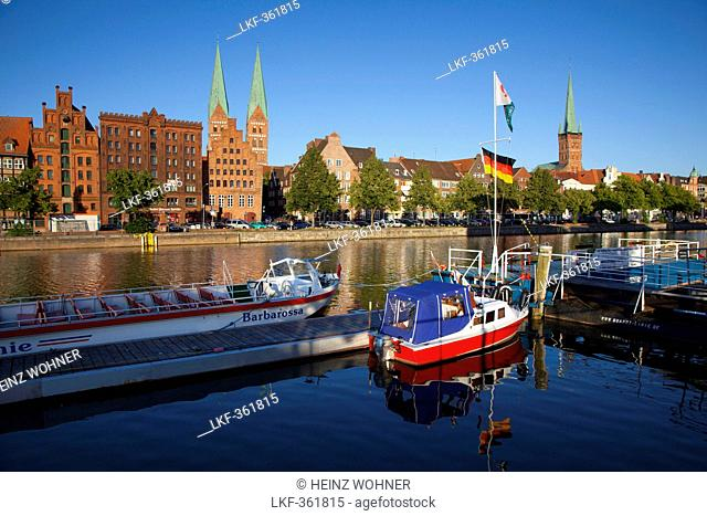 Old storehouses at Holsten harbour, St Mary's church and church of St Petri, Hanseatic city of Luebeck, Baltic Sea, Schleswig-Holstein, Germany