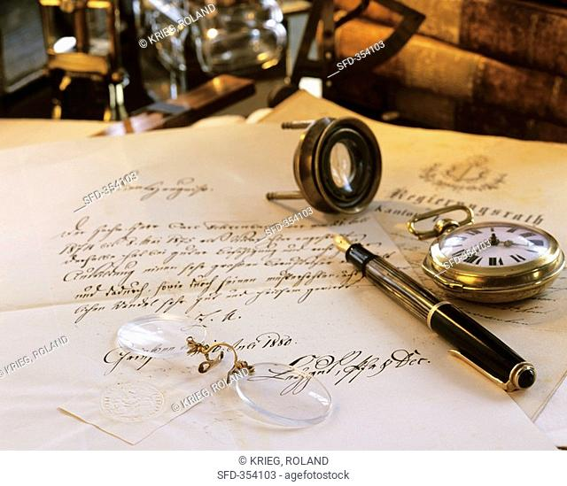 Antique desk with letter, fountain pen, pocket watch