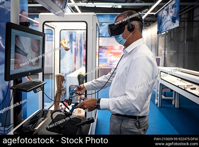 09 June 2021, North Rhine-Westphalia, Dortmund: Peter Fischer, demonstration technician, demonstrates a laparoscopy simulator at the German Occupational Safety...
