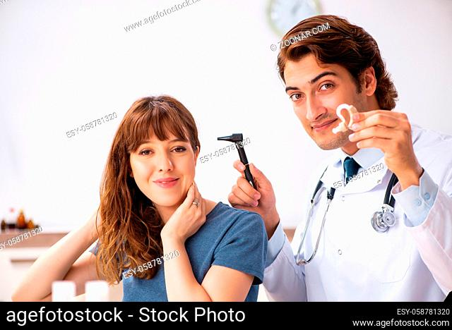 Patient with hearing problem visiting doctor otorhinolaryngologist