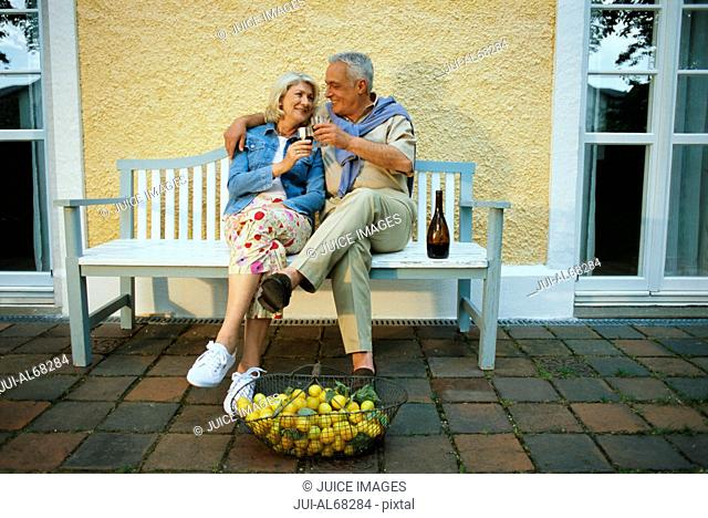 Mature couple sitting on a bench