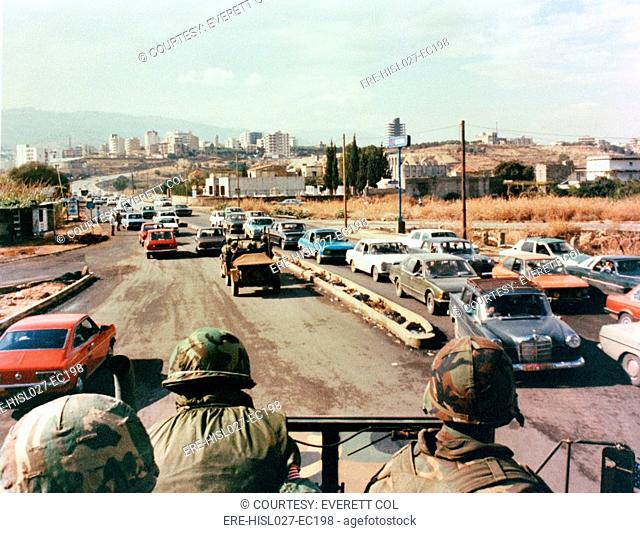 US Marines patrol the streets of Beirut Lebanon in a truck during a multinational peacekeeping operation. 1983. BSLOC-2011-12-179