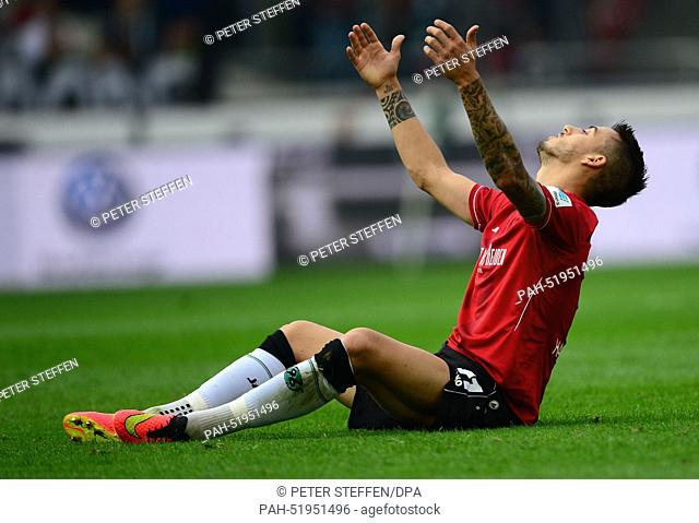 Hanover's Joselu sits on the pitch and gestures during the Bundesliga soccer match between Hannover 96 and Hamburger SV in Hanover, Germany, 14 September 2014