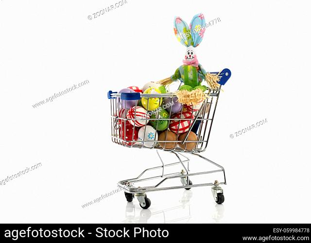 shopping cart with easter eggs and bunny isolated on white