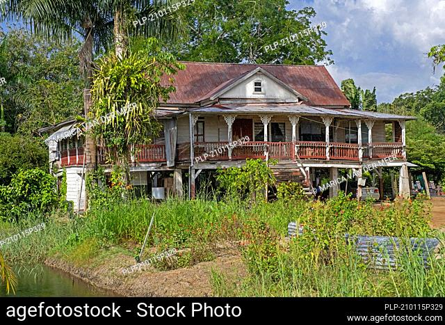 Dilapidated director's house of Peperpot, former coffee and cacao plantation in the Commewijne District in northern Suriname / Surinam
