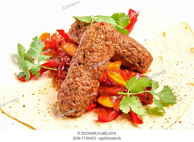kebab and vegetables in sauce