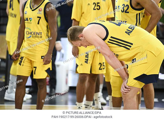 17 February 2019, Bavaria, Bamberg: Basketball: BBL Cup, Brose Bamberg - ALBA Berlin, Final: Berlin's Luke Sikma (r) bends forward after defeat