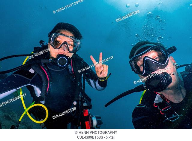 Scuba divers in Indian Ocean, Maldives