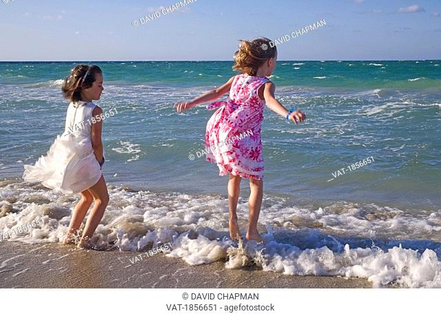Two young girls by seashore
