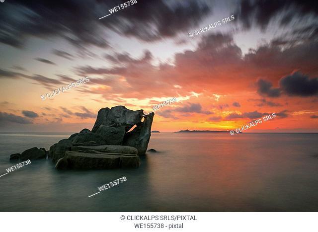 italy, Sardinia, Villasimius, dawn on reefs of Punta Molenti beach