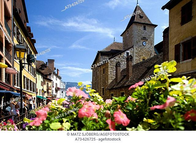 The Palais (palace) de l'Ile and the flowers of the riverside. Annecy. France