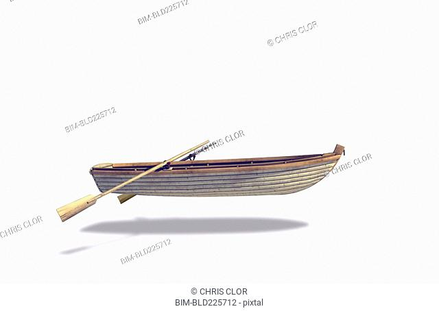 Rowboat and oars floating in white background