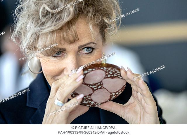 13 March 2019, Thuringia, Erfurt: Birgit Keller (Linke), Minister for Infrastructure and Agriculture, smells a blood sausage on the 23rd day of the Thuringian...