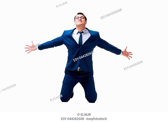Excited businessman siiting on the knees isolated on white background