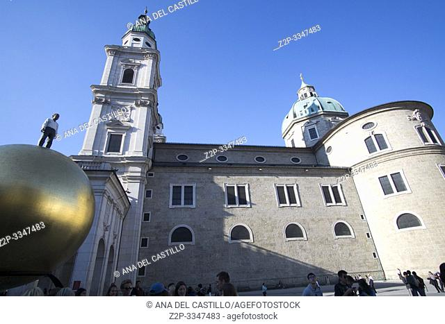 SALZBURG AUSTRIA ON APRIL 17, 2019: Historic town of Salzburg with Man on the Golden Ball in Kapitelplatz (Chapter Square)