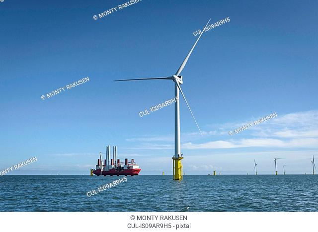 View of offshore windfarm and construction ship from service boat
