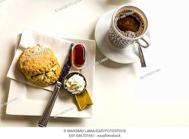 coffee and scones with clotted cream and jam, strawberries