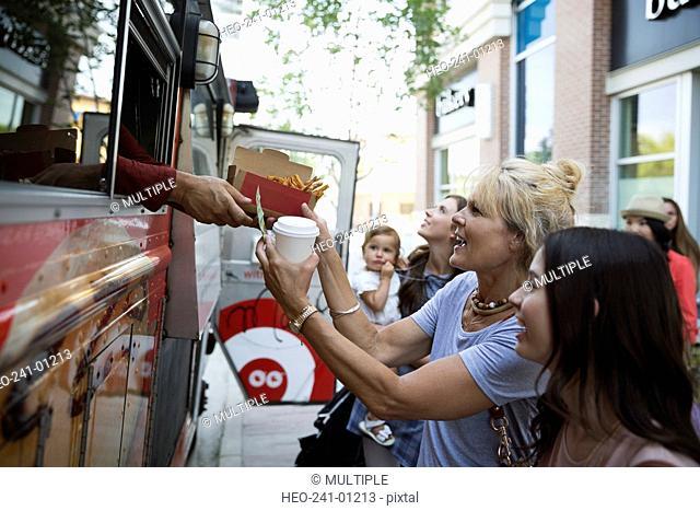 Customers receiving food outside food truck