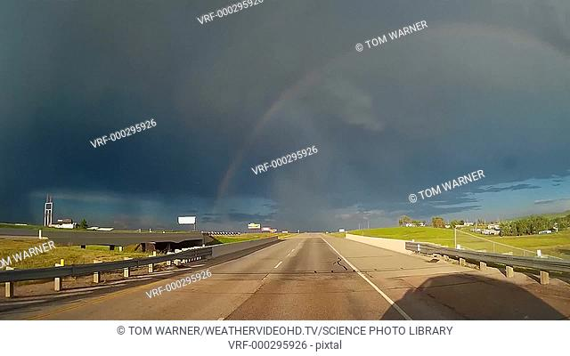 Timelapse footage of a double rainbow seen from a moving car along the road, South Dakota, USA
