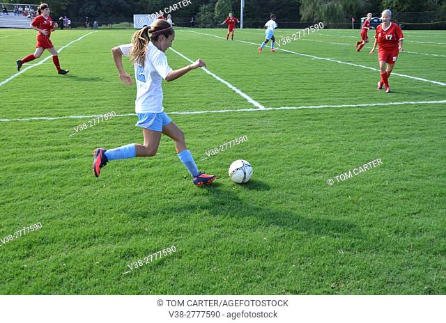 Teen playing high school soccer