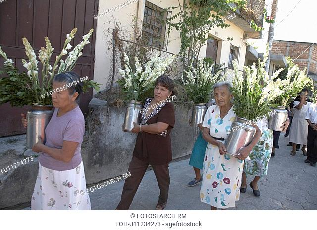 flowers women el salvador marching in procession