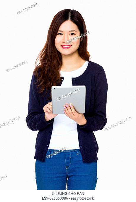 Asian Woman use of the digital tablet