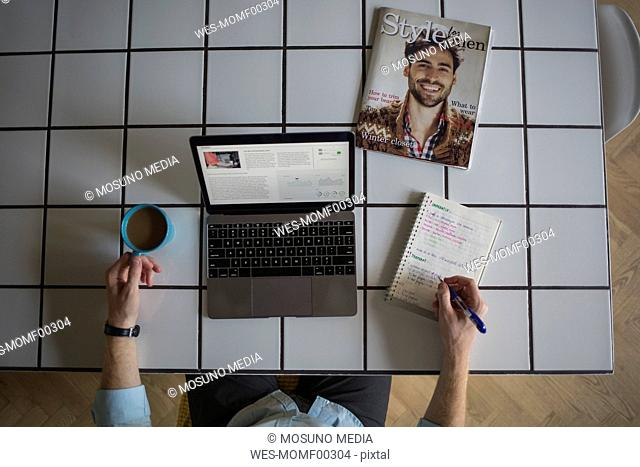 Freelance businessman working at home, top view