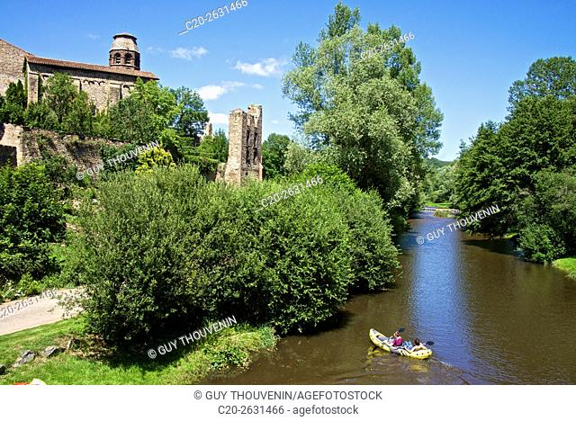 Ruins and benedictine abbey tower, along the Senouire river, and canoeing, at Lavaudieu, medieval village, 43, Auvergne, Haute Loire, France