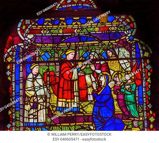 Virgin Mary Priest Sacrement Stained Glass Window Orsanmichele Church Florence Italy. Church and stained glass from 1400s