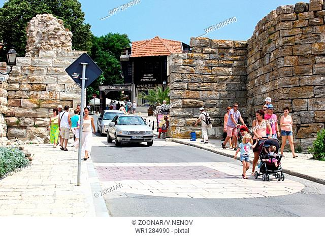 Nesebar, Bulgaria - 06/23/2013: People visit Old Town on June 23, 2013 day of Nessebar, Bulgaria. Nessebar in 1956 was declared as museum city