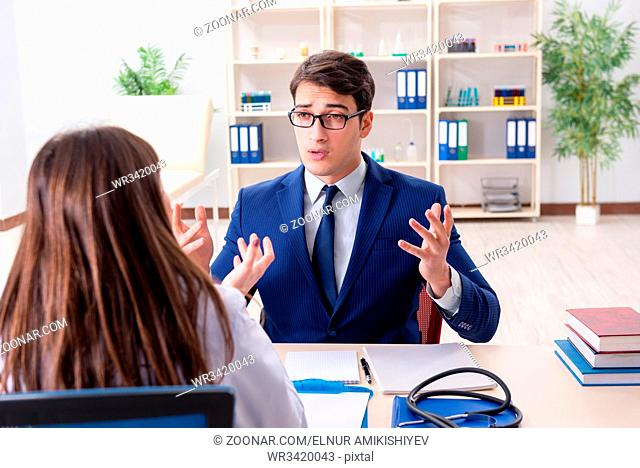 Businessman discussing health issues with doctor