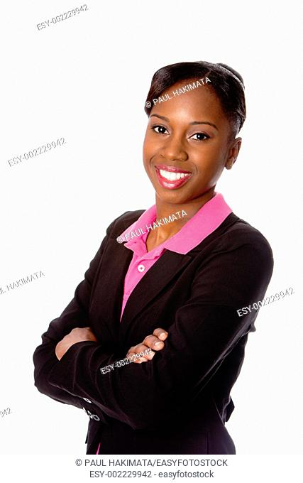 Beautiful happy smiling African business woman in suit and arms crossed, isolated