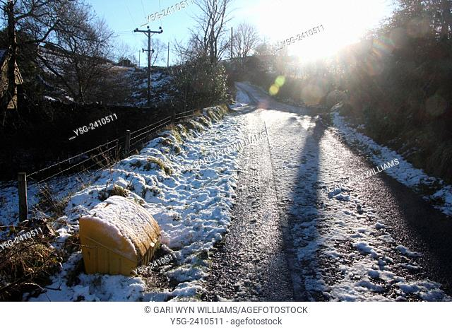 Yellow grit box on snow covered rural hill in wales great britain uk