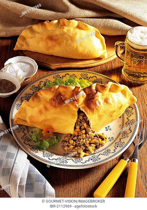 Cornish pasties, filling of onions, carrots, potatoes and tender lean beef, United Kingdom