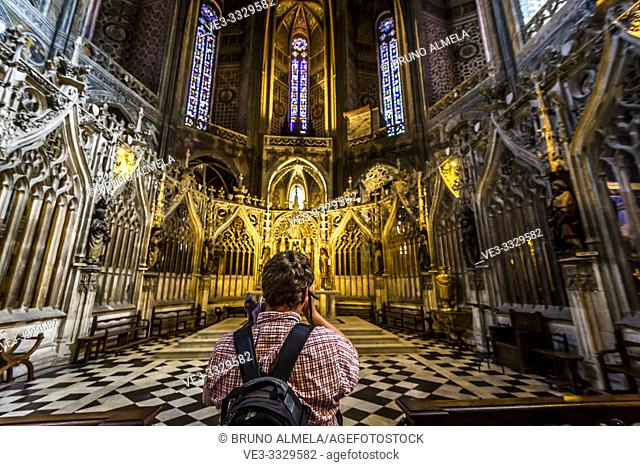 Tourist inside of Albi Cathedral (Tarn Department, Occitanie Region, France)