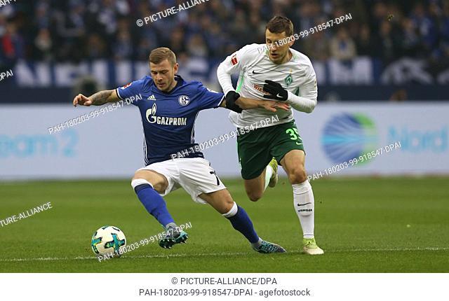 Schalke's Max Meyer and Bremen's Maximilian Eggestein (r) vie for the ball during the German Bundesliga football match between FC Schalke 04 and Werder Bremen...