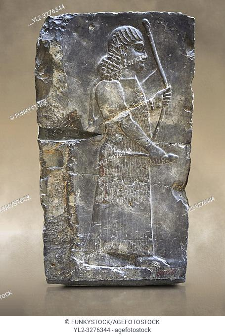 Stone relief sculptured panel of an archer. Inv AO 19885 from Dur Sharrukin the palace of Assyrian king Sargon II at Khorsabad, 713-706 BC