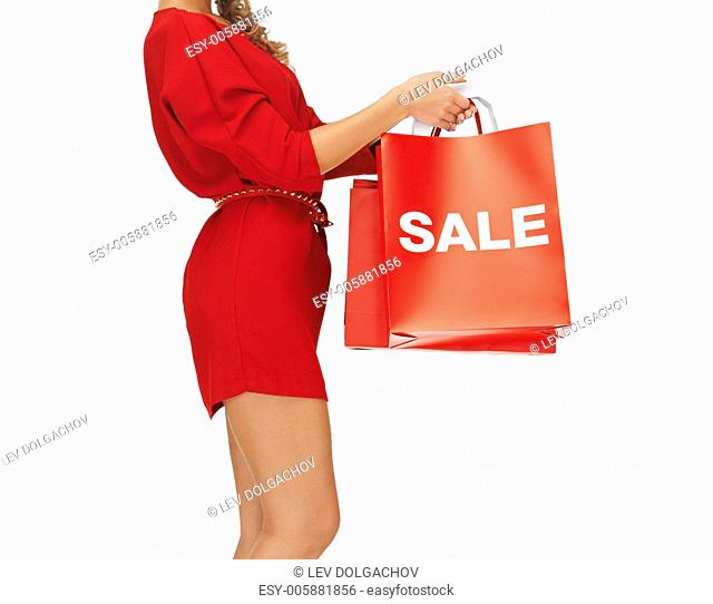 closeup picture of woman holding shopping bags
