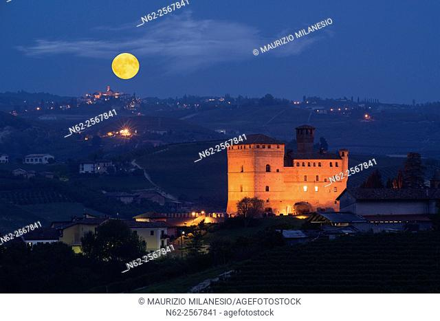 View in the night with a full moon on the Castle of Grinzane Cavour Unesco heritage in the territory of the Langhe Piedmont Italy