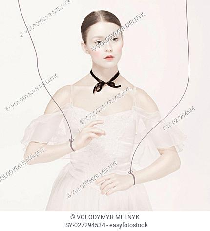 The ballet dancer as puppet dancing over white background