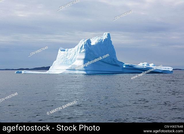 Majestic iceberg formation over sunny Atlantic Ocean Greenland